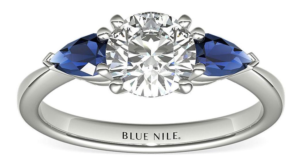 platinum solitaire diamond and blue sapphire ring